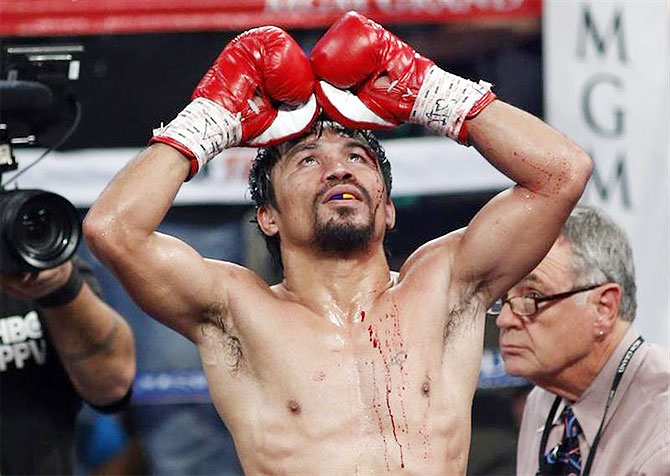Manny Pacquiao of the Philippines celebrates his unanimous decision victory over WBO welterweight champion Timothy Bradley of the U.S. on Saturday