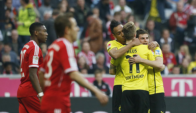 Borussia Dortmund's Pierre-Emerick Aubameyang (3rd from left) Marco Reus (2nd from right) and Jonas Hofmann (right) celebrate a goal against Bayaern Munich during their Bundesliga match in Munich on Saturday