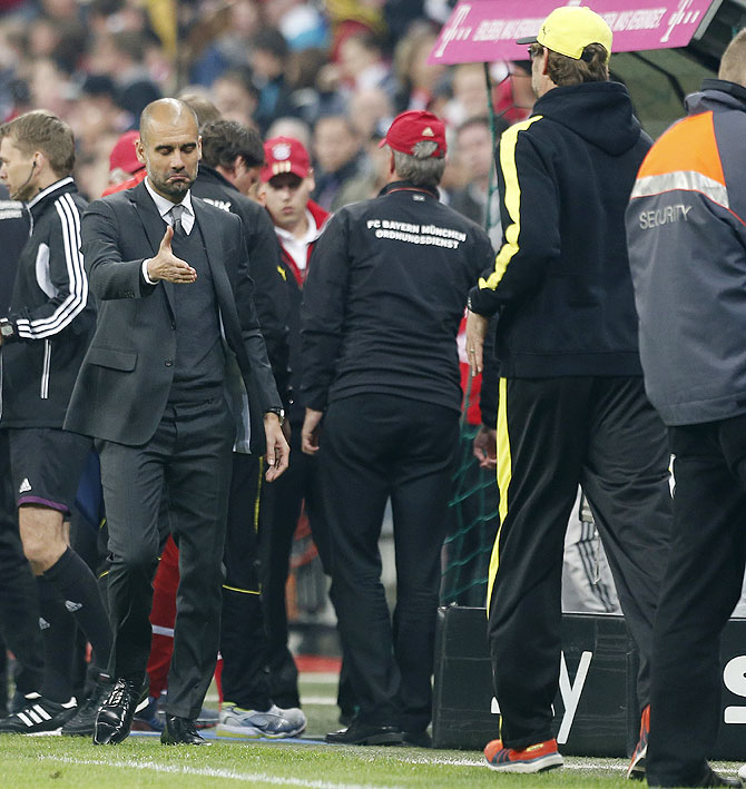 Bayern Munich's coach Pep Guardiola (left) congratulates Borussia Dortmund's coach Juergen Klopp after their Bundesliga match in Munich on Saturday