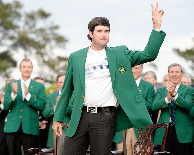Bubba Watson of the United States poses with the green jacket after winning the 2014 Masters Tournament by a three-stroke margin at the Augusta National Golf Club in Augusta, Georgia on Sunday