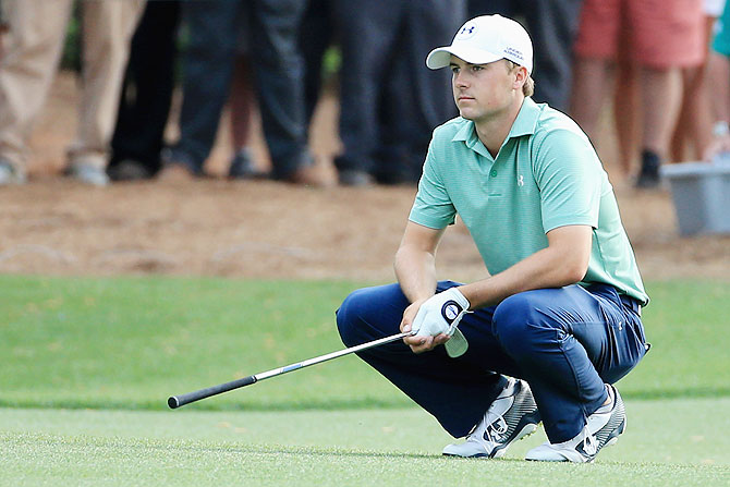 Jordan Spieth of the United States reacts to a poor shot on the 14th hole during the final round of the 2014 Masters Tournament at Augusta National Golf Club on Sunday