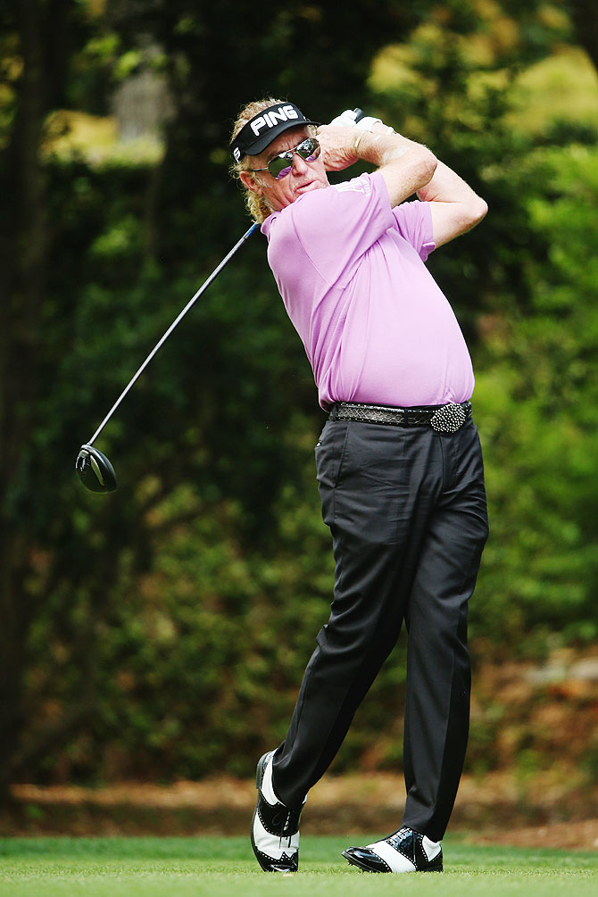 Miguel Angel Jimenez of Spain hits his tee shot on the second hole during the final round of the 2014 Masters Tournament at Augusta National Golf Club on Sunday