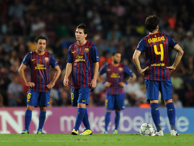 Lionel Messi and his Barcelona teammates stand dejected
