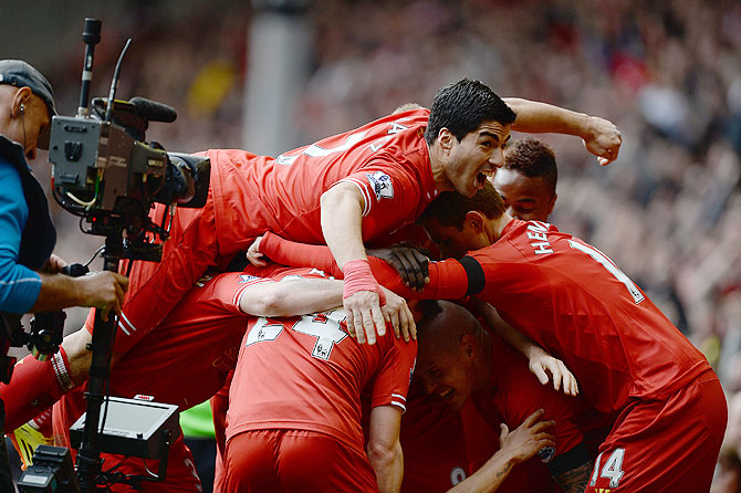 Liverpool players celebrate a goal by Philippe Courtinho (obscured) during their match against Manchester City during their English Premier League match at Anfield in Liverpool on Sunday