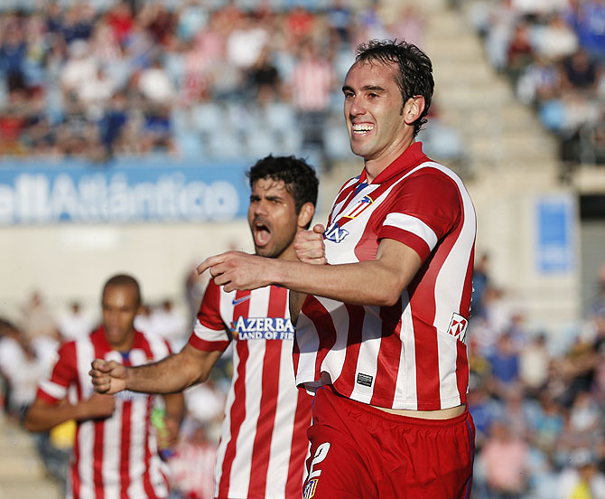 Atletico Madrid's Diego Godin (right) celebrates his goal against Getafe during their La Liga match at Coliseum Alfonso Perez stadium in Getafe, outside Madrid on Sunday