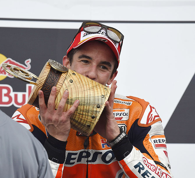 Marc Marquez of Spain and Repsol Honda Team celebrates on the podium at the end of the MotoGp Red Bull U.S. Grand Prix of The Americas race at Circuit of The Americas on Sunday