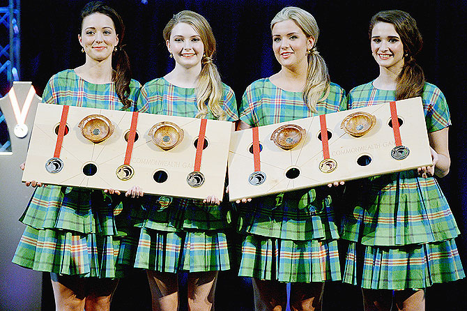 Lily Forbes, Kathryn Malone, Sarah Bird and Sara Montaghain present the Commonwealth Games Gold, Silver and Bronze medals at the unveiling at Kelvingrove Art Gallery and Museum in Glasgow, Scotland on Monday