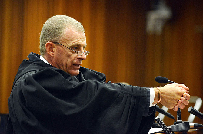 State prosecutor Gerrie Nel questions Oscar Pistorius during cross examination in Pretoria High Court on Monday