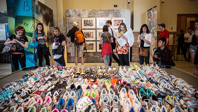 Runner's shoes are laid out in a display titled, 'Dear Boston: Messages from the Marathon Memorial' in the Boston Public Library to commemorate the 2013 Boston Maraton bombings, on Tuesday