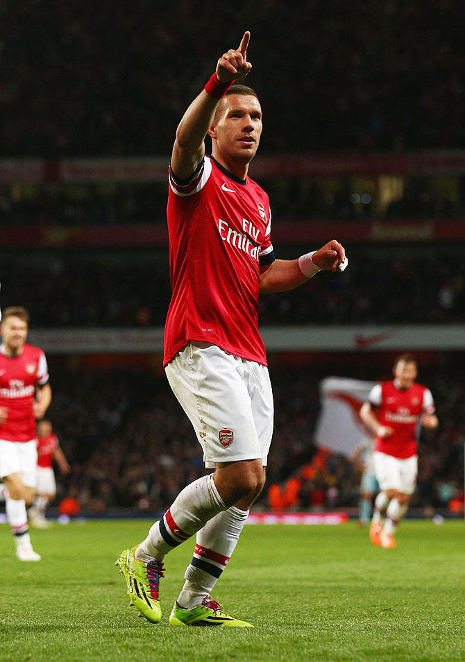 Arsenal's Lukas Podolski celebrates after scoring against West Ham United during their English Premier League match at Emirates Stadium on Tuesday