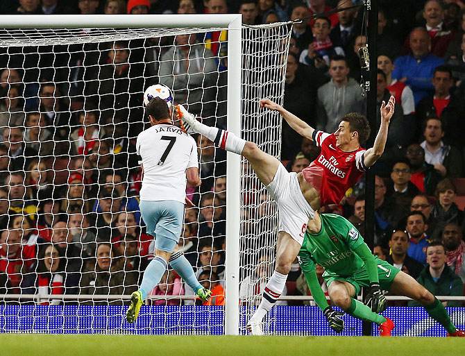 West Ham United's Matthew Jarvis (left) scores as he is challenged by Arsenal's Laurent Koscielny on Tuesday