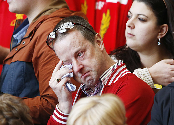A man weeps during a memorial service to mark the 25th anniversary of the Hillsborough disaster at Anfield in Liverpool on Tuesday