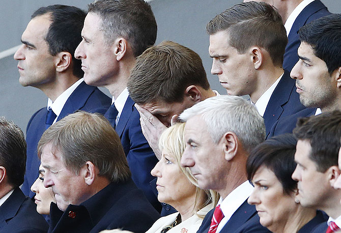 Liverpool's captain Steven Gerrard (centre) reacts during a memorial service to mark the 25th anniversary of the Hillsborough disaster at Anfield on Tuesday