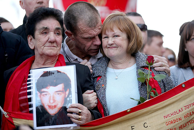 Family members of a victim of the disaster also part of the Hillsborough Justice Campaign group march to Anfield for a memorial service marking the 25th anniversary of the Hillsborough Disaster at Anfield stadium on Tuesday
