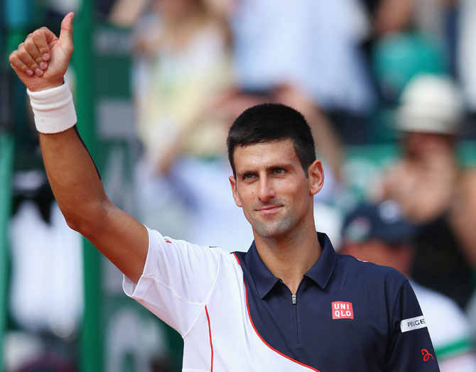 Novak Djokovic of Serbia thanks the support after defeating Albert Montanes of Spain