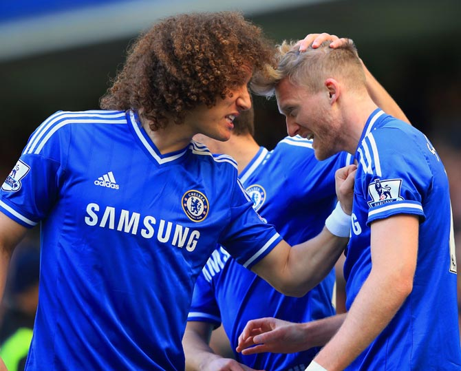 Andre Schurrle (right) celebrates scoring the second goal for Chelsea with team mate David Luiz