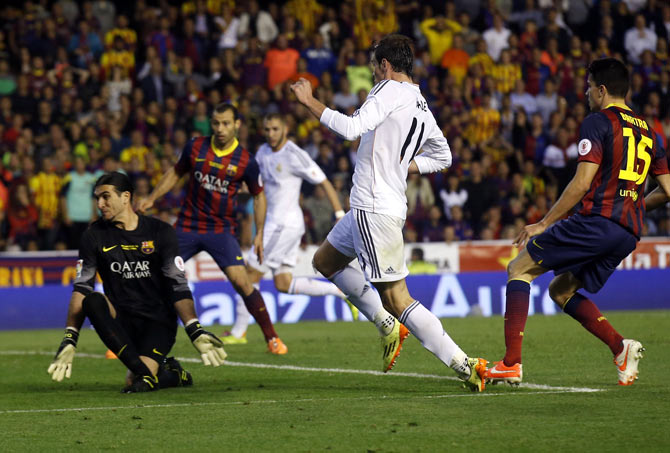 Real Madrid's Gareth Bale scores past Barcelona's goalkeeper Pinto during their King's Cup final at Mestalla stadium in Valencia on Wednesday
