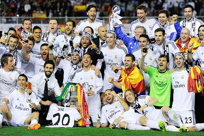 Real Madrid CF players celebrate with the trophy after winning the Copa del Rey King's Cup final against FC Barcelona at Estadio Mestalla in Valencia on Wednesday