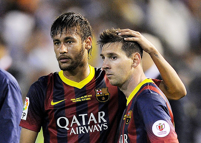 Lionel Messi (right) and Neymar of FC Barcelona react after the Copa del Rey King's Cup final on Wednesday