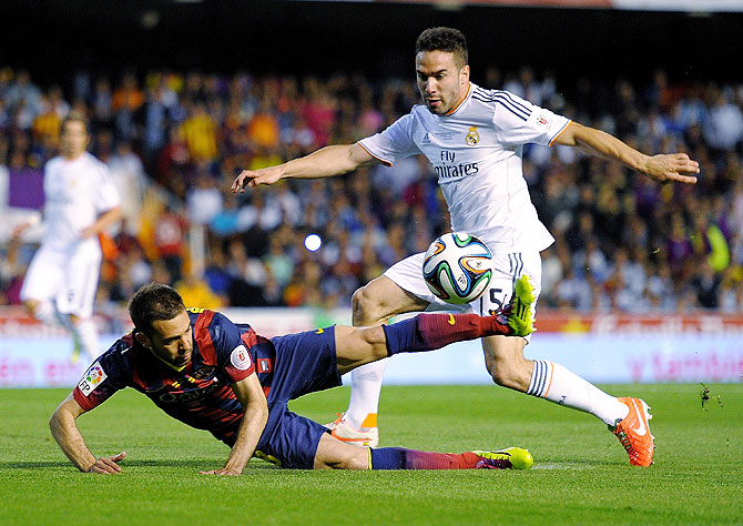 Jordi Alba (left) of Barcelona is tackled by Daniel Carvajal of Real Madrid on Wednesday