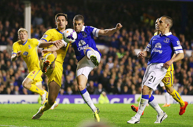 Jose Campana of Crystal Palace and Kevin Mirallas of Everton compete for the ball during their match on Wednesday