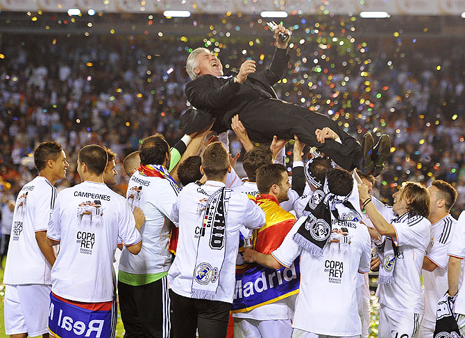 Real Madrid's manager Carlo Ancelotti is thrown into the air by his players after Real beat Barcelona to win the Copa del Rey final on Wednesday