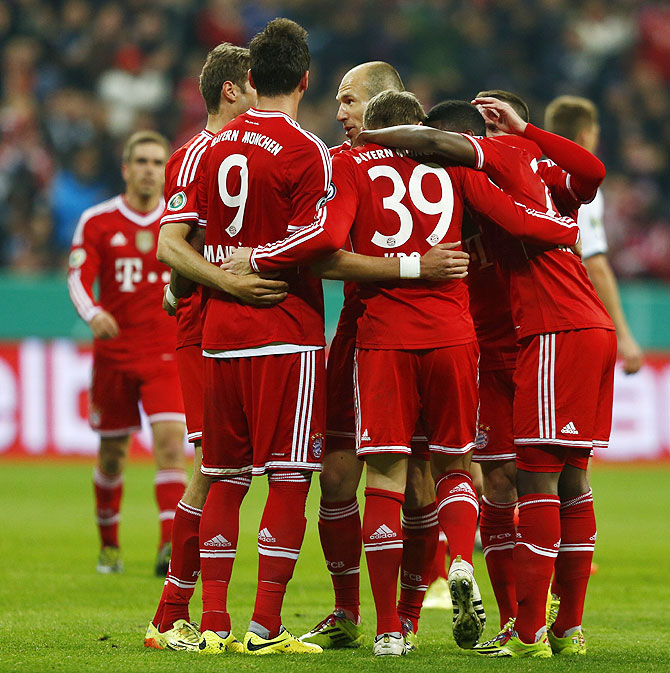 Bayern Munich's players celebrate after Tony Kroos scored a goal against 1.FC Kaiserslautern during their German soccer cup (DFB Pokal) semi-final match in Munich on Wednesday
