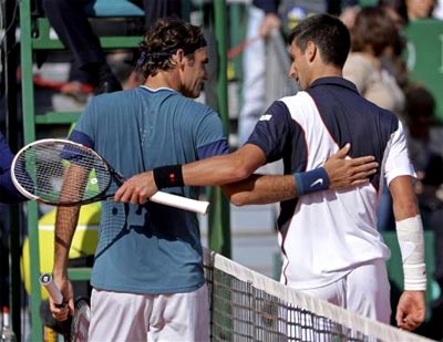 Rediff Sports - Cricket, Indian hockey, Tennis, Football, Chess, Golf - Federer ousts ailing Djokovic in Monte Carlo semis