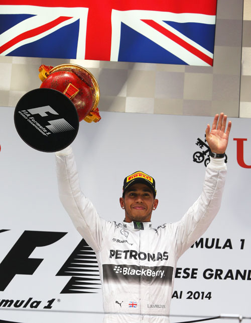 Lewis Hamilton of Great Britain and Mercedes GP celebrates his victory at the Shanghai International Circuit