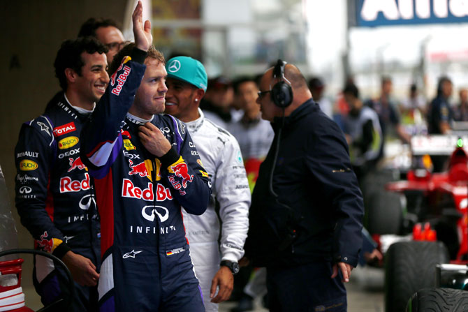 Sebastian Vettel of Germany and Infiniti Red Bull Racing waves to the fans