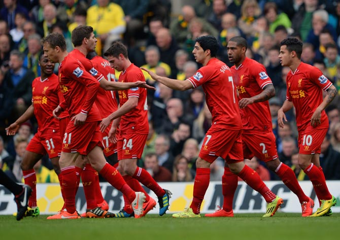 Liverpool players celebrate a goal during their match against Norwich City