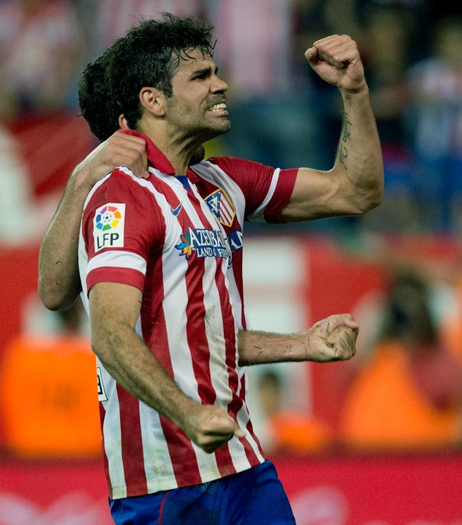 Diego Costa of Atletico de Madrid celebrates scoring their second goal against Elche