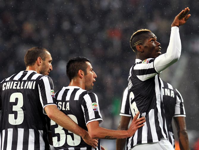 Paul Pogba (right) of Juventus celebrates after scoring the opening goal against Bologna