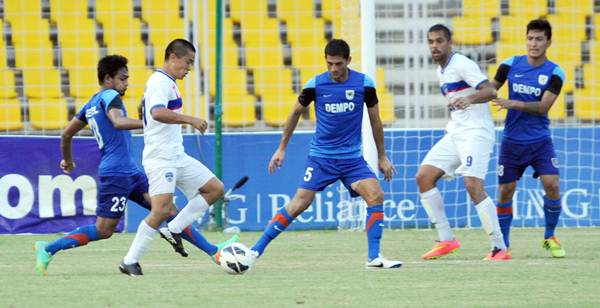 Sunil Chhetri tries to break through a host of Dempo defenders in Monday's I-League match