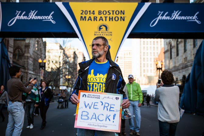 Bill Sved, who says he ran the Boston Marathon last year and is running again this year, poses for a portrait at the finish line of the Boston Marathon on April 19, 2014.