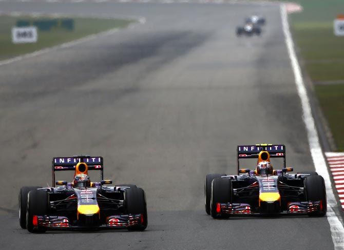 Sebastian Vettel (left) tries to pass Red Bull team mate Daniel Ricciardo