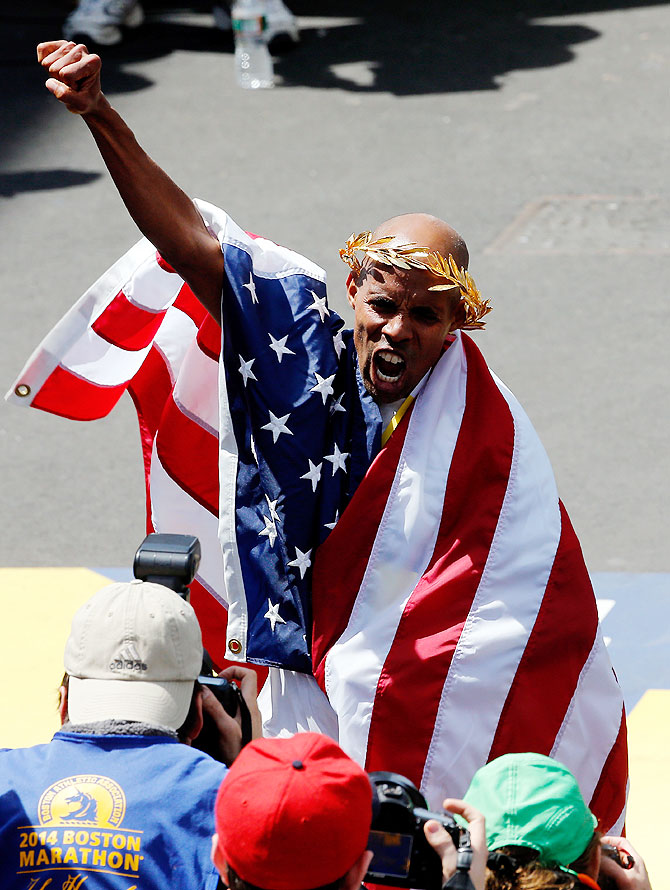Meb Keflezighi of the United States celebrates after winning the 118th Boston Marathon on Monday