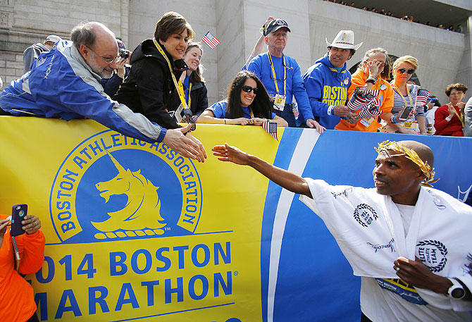Meb Keflezighi of the U.S. (right) is congratulated after winning the men's division of the 118th Boston Marathon on Monday