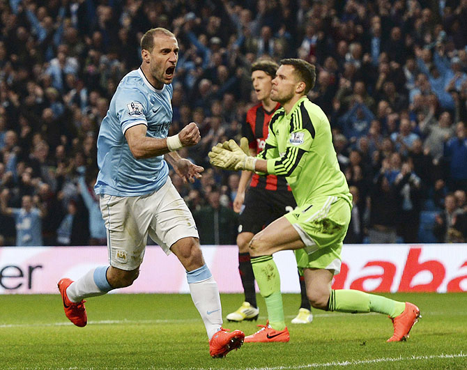 Manchester City's Pablo Zabaleta (left) celebrates after scoring a goal against West Bromwich Albion on Monday
