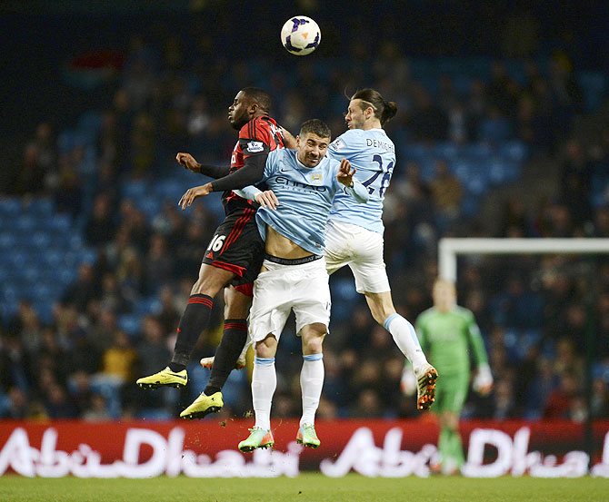 Manchester City's Martin Demichelis (right) and Aleksandar Kolarov (centre) challenge West Bromwich Albion's Victor Anichebe on Monday