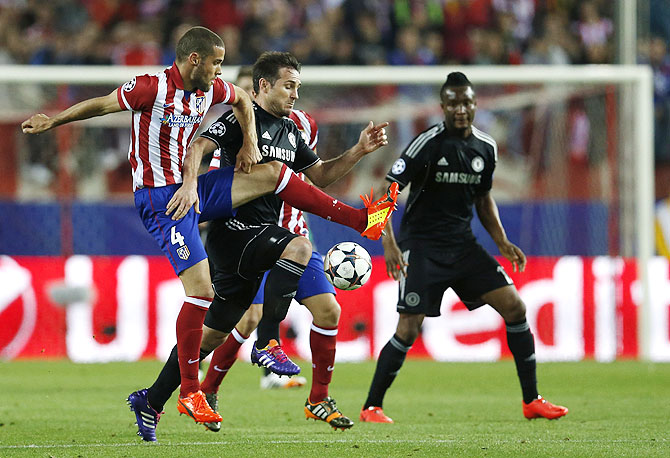 Chelsea's Frank Lampard (left) challenges Atletico Madrid's Mario Suarez during their Champions League semi-final first leg match at Vicente Celderon Stadium on Tuesday