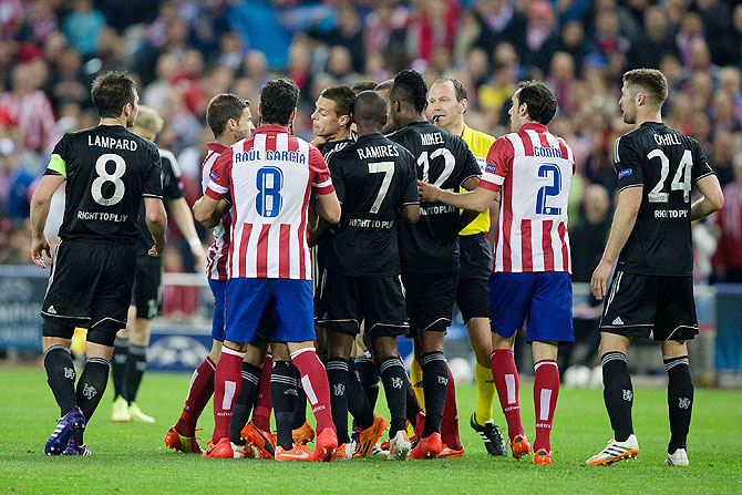 Gabi Fernandez of Atletico de Madrid and Cesar Azpilicueta of Chelsea FC get into a fight and create a commotion during their Champions League semi-final first leg match on Tuesday