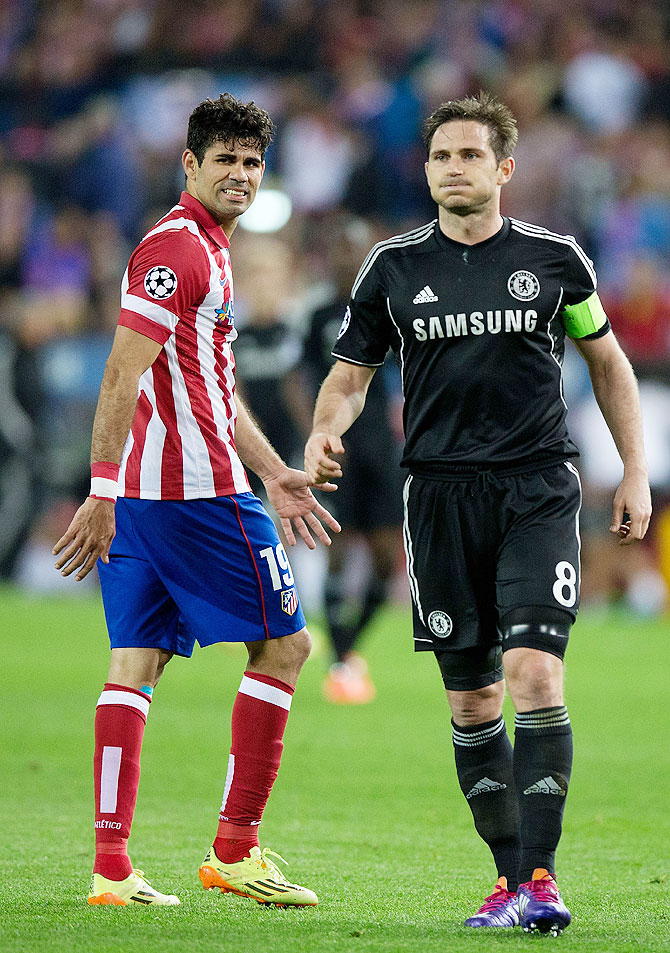 Diego Costa (left) of Atletico de Madrid looks on with Frank Lampard (right) of Chelsea FC during their Champions League semi-final first leg match at Vicente Calderon Stadium on Tuesday