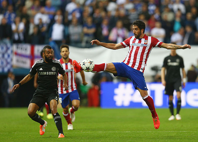 Ashley Cole of Chelsea battles for the ball with Raul Garcia of Atletcio Madrid during the Champions League semi-final first leg match at Vicente Calderon Stadium on Tuesday