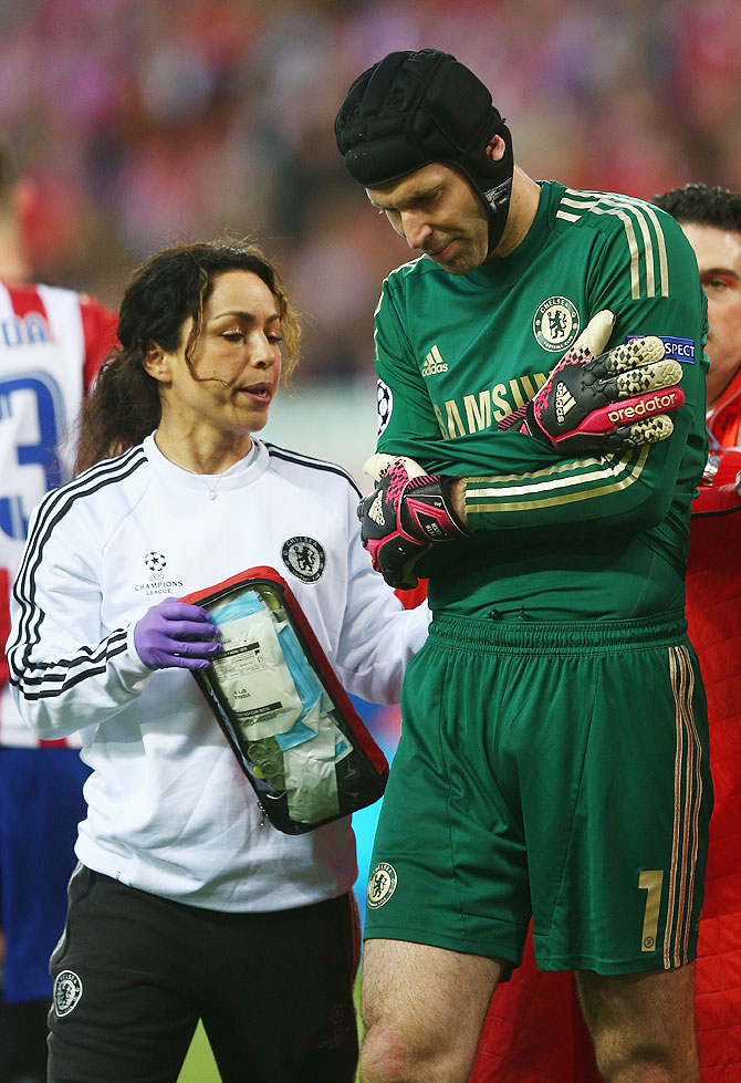 Petr Cech walks off the pitch after being injured during the Champions League semi-final first leg match between Club Atletico de Madrid and Chelsea at Vicente Calderon Stadium on Tuesday