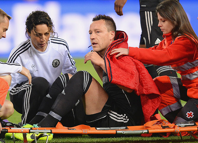 An injured John Terry of Chelsea receives treatment during the Champions League semi-final first leg match against Club Atletico de Madrid