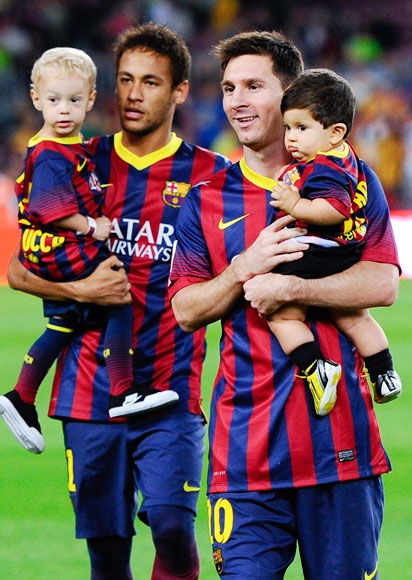 Neymar of FC Barcelona with son Davi Lucca (left) and team-mate Lionel Messi with son Thiago