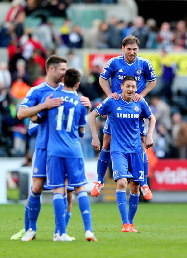 Chelsea players celebrate their 1-0 victory over Swansea City in the Barclays Premier League match at Liberty Stadium on April 13.