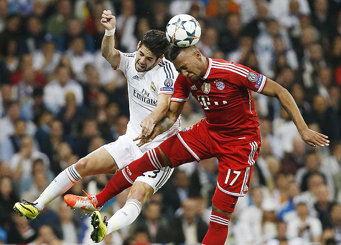 Real Madrid's Isco (left) challenges Bayern Munich's Jerome Boateng during their Champions League semi-final first leg match on Wednesday