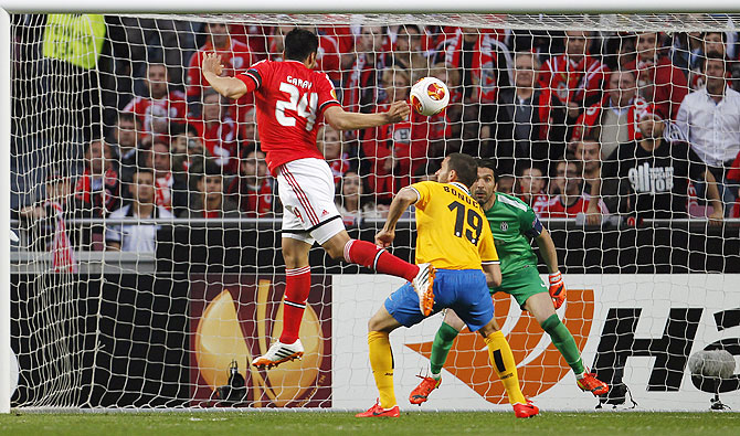 Benfica's Ezequiel Garay (left) heads to score near Juventus's Leonardo Bonucci during their Europa League semi-final first leg match at Luz stadium in Lisbon on Thursday